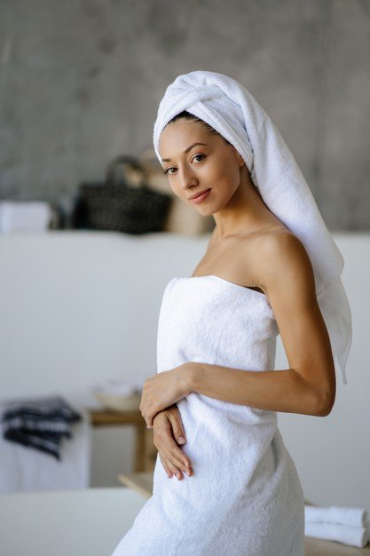 relaxed-young-caucasian-female-model-white-towel-feels-refreshed-after-taking-shower-has-healthy-clean-soft-skin-poses-cozy-bathroom-women-beauty-hygiene-concept_