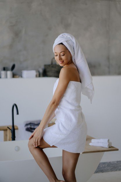 relaxed-young-female-model-white-towel-feels-refreshed-after-taking-shower_1153-7365